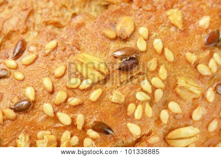detail of bread roll with flax and sesame seeds