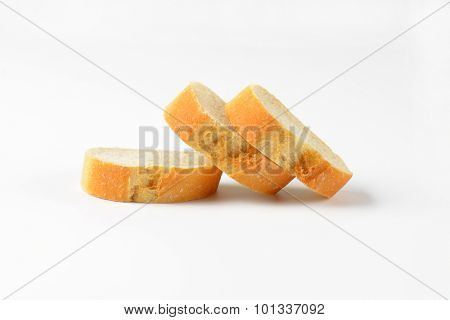slices of freshly baked bread roll on white background