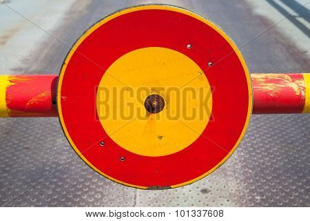 Round Red And Yellow Stop Sign On Turnpike