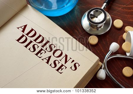 Addisons disease written on book with tablets.