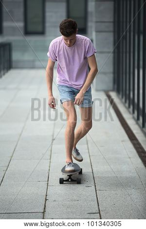 Stylish teenager riding a longboard
