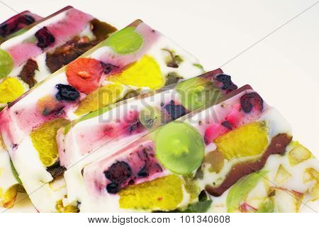 Pieces Of Jelly Cake With Fruits And Milk