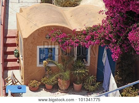 Greek Red Building With Patio And Flowers, Santorini Island, Greece