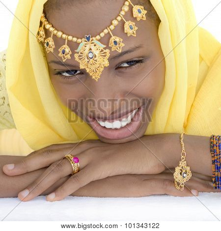 Young Afro beauty dressed for a celebration, isolated