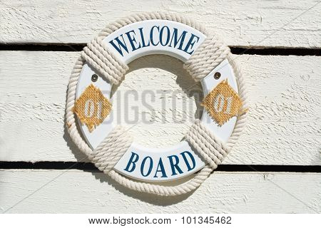 Welcome Life Buoy on a white planks