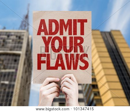 Admit Your Flaws cardboard with cityscape background