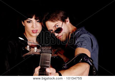 Couple Looking Down Guitar