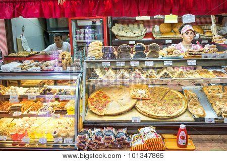 Budva, Montenegro - September 05, 2015: Unidentified Woman Sells Pizza In A Small Street Pizzeria
