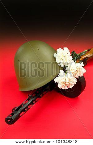 Machine Gun And Flowers