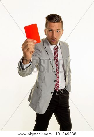 a manager holding a red card in hand. symbolic photo for resignation or dismissal