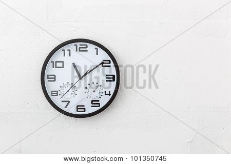 Big Round Clock On White Wall.