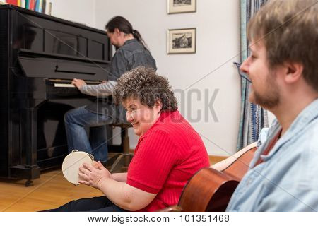 Mentally Disabled Woman Learning A Music Instrument