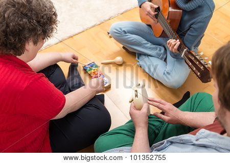 Three Persons Playing Sundry Instruments