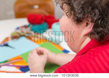 Mentally Disabled Woman With A Lot Of Handicraft
