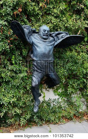 Statue of jumping director Sergei Parajanov in old part of Tbilisi,Georgia