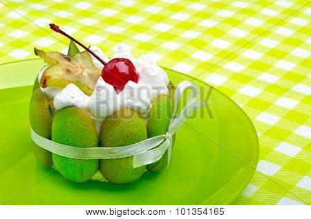 Delicious Green Cake With Cherry And Carambola On Green Plate On Green Background