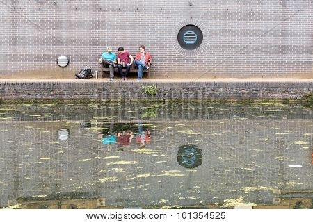 Three Guys Chatting Near Canal