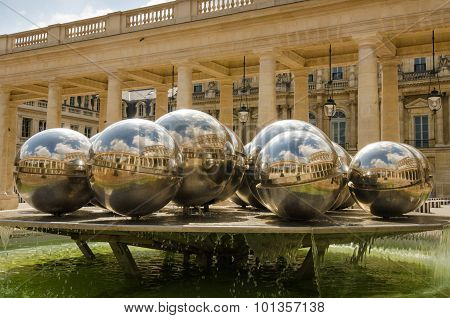 Silver balls in the fountain designed by Pol Bury reflect courtyard of Palais Royal
