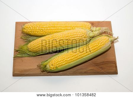 Ripe Fruits Of Corn On A Wooden Surface