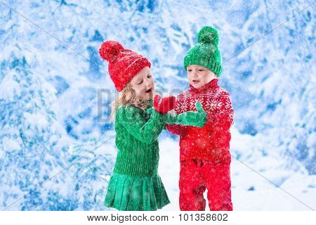 Kids Playing In Snowy Winter Forest