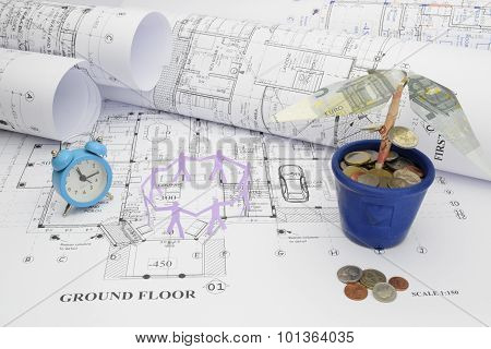 Blueprints, Time, Manpower, And Money Tree  In Construction Project