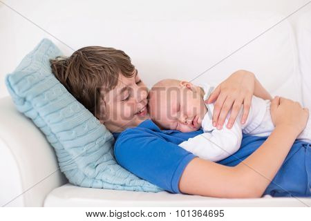 Boy Holding His Newborn Baby Brother