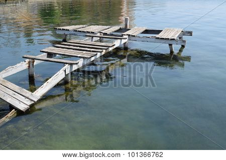 Old Rotten Boat Bridge In A Ghost Town