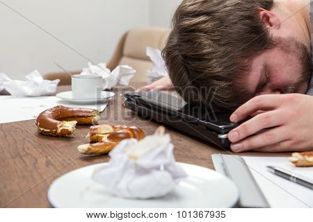 Man With Burnout Sleeping On His Dirty Desk