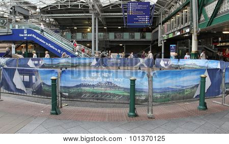 EDINBURGH, SCOTLAND - SEPTEMBER 11: Advertising banners for recently opened Borders Railway on inside Waverley Station September 11, 2015 Edinburgh, Scotland