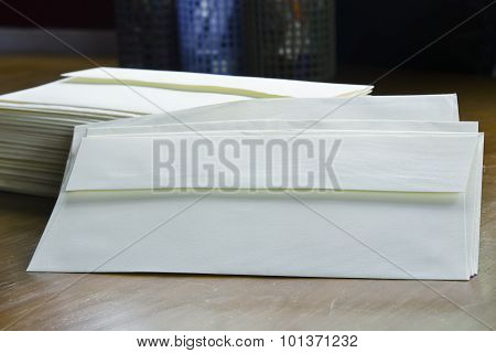 Pile of envelopes and books background with highlighted depth of field