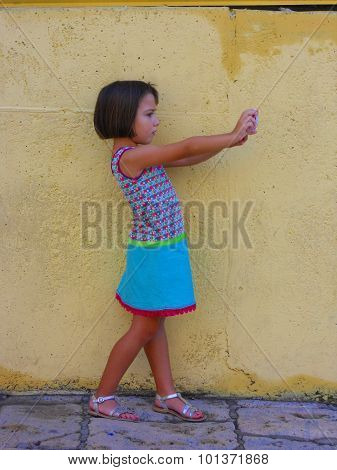 A girl taking photos in the street