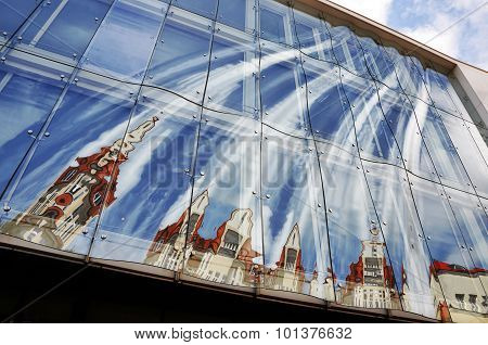 Glass facade reflects the old building in Sopot, Poland