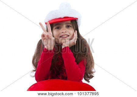 Little girl with a santa claus hat isolated on white