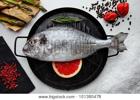 Raw Dorada Fish With Ingredients