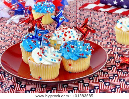 Patriotic Cupcakes Wih Red, White And Blue Decorations.
