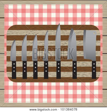 Set Of Knives. Chopping Board. Table-napkin. Wooden Table. Top View.