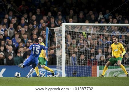LONDON ENGLAND 23 NOVEMBER 2010. Chelsea's midfielder Florent Malouda takes a shot at goal during the UEFA Champions League match between Chelsea FC and MSK Zilina, played at Stamford Bridge.