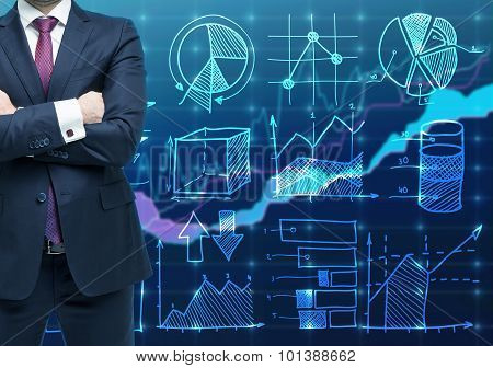A Person With Crossed Hands And In Formal Suit As A Trader Or Analyst. Financial Chart On The Backgr