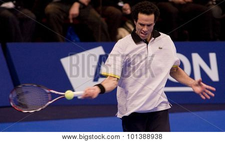 LONDON, ENGLAND. 04 DECEMBER 2009 -    Younes El Aynaoui (MOR) plays a shot during the match with Mark Philippoussis (AUS) during the AEGON Masters Tennis, Royal Albert Hall, London.