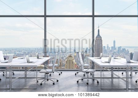 Workplaces In A Modern Panoramic Office, New York City View From The Windows. A Concept Of Financial