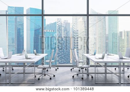 Workplaces In A Modern Panoramic Office, Singapore City View From The Windows. A Concept Of Financia
