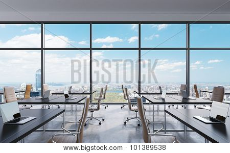 Workplaces In A Modern Panoramic Office, New York City View From The Windows. Open Space. White Tabl