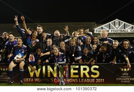 LONDON, ENGLAND. 26 MAY 2011  Lyon players with the trophy after winning the 2011UEFA Womens Champions League final between FFC Turbine Potsdam from Germany and Olympique Lyonaise from France