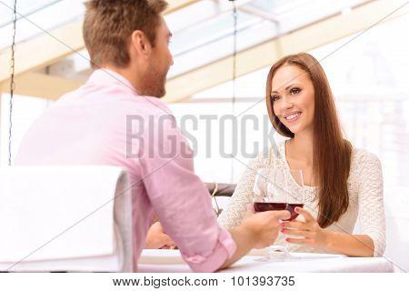 Loving couple drinking wine