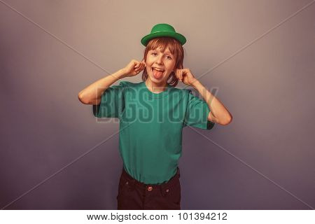 European-looking boy of ten years smiley shows the language in a