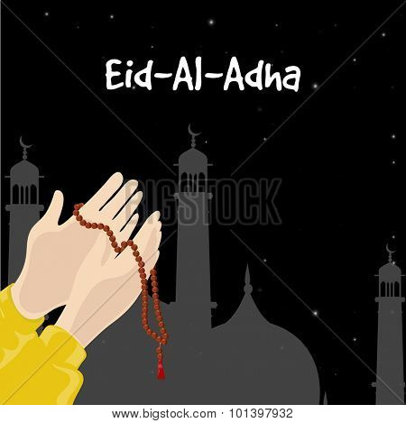 Muslim Community Festival of Sacrifice, Eid-Al-Adha celebration with illustration of praying hands holding Rosary ( Tasbih ) in front of Mosque on night background.