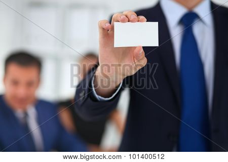 Close-up of a businessman holding a blank business card