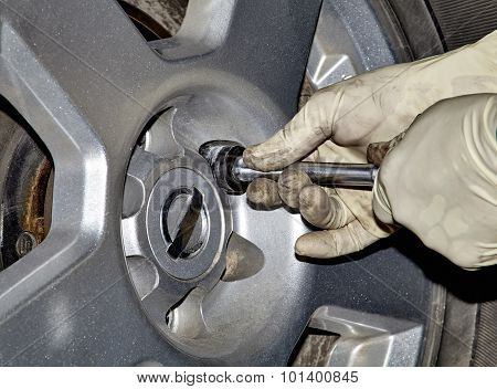 Mechanic Removing Lug Nut