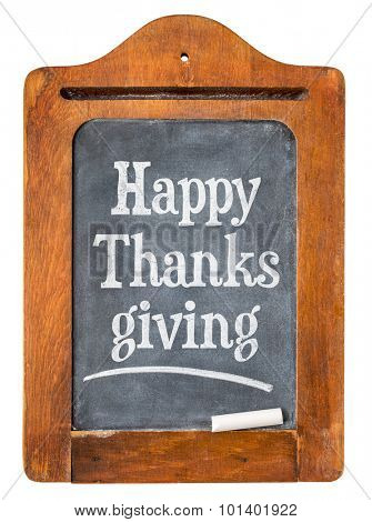 Happy Thanksgiving - white chalk text  on a small slate message blackboard isolated on white