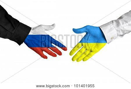 Russia and Ukraine leaders shaking hands on a deal agreement